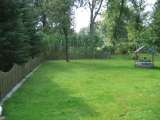 Das Ferienhaus - Garten von links